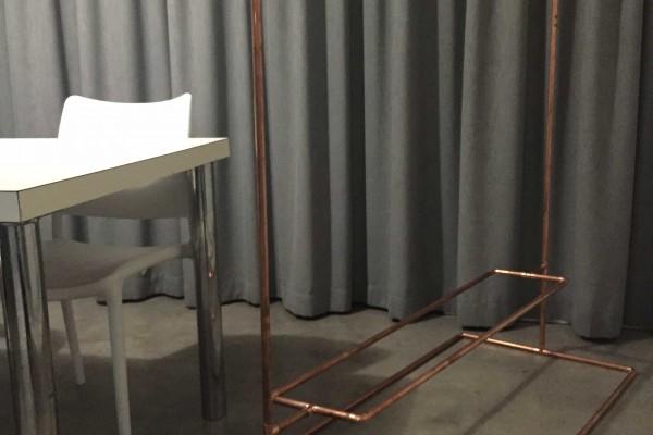 Clothing rail with shelf